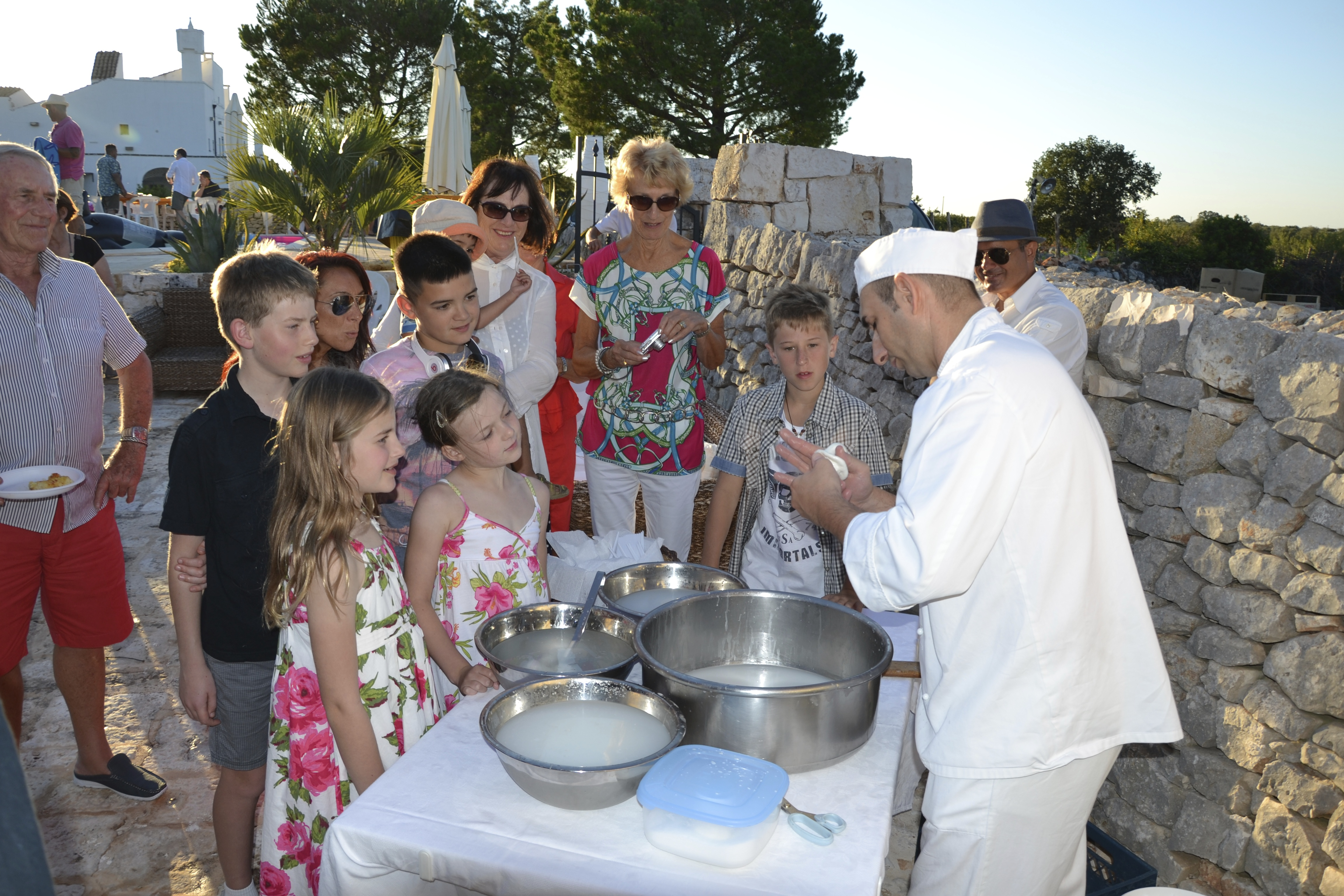 The Cheese man makes fresh mozzarella at our pre wedding dinner held at the Masseria Della Zingara