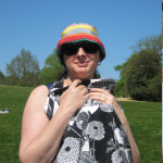 Sunshade over a baby carrier.  So easy.  (Yes this is me!)